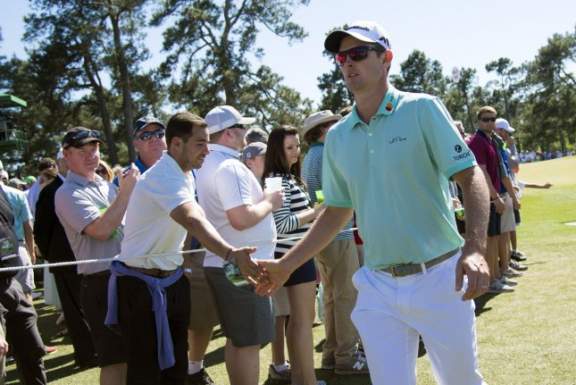 Justin Rose greets patrons as he walks to the 8th tee box during the third round of the 2017 Masters Tournament at Augusta National Golf Club in Augusta, Georgia on April 8, 2017. Photo by Kevin Dietsch/UPI