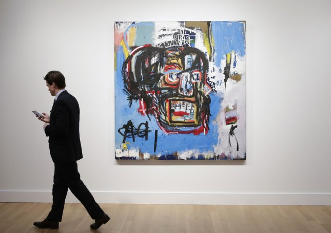 Jean-Michel Basquiat's 1982 painting Untitled -- on display at a media preview -- sold Thursday at Sotheby's New York auction of contemporary art for a record $110.5 million. Photo by John Angelillo/UPI