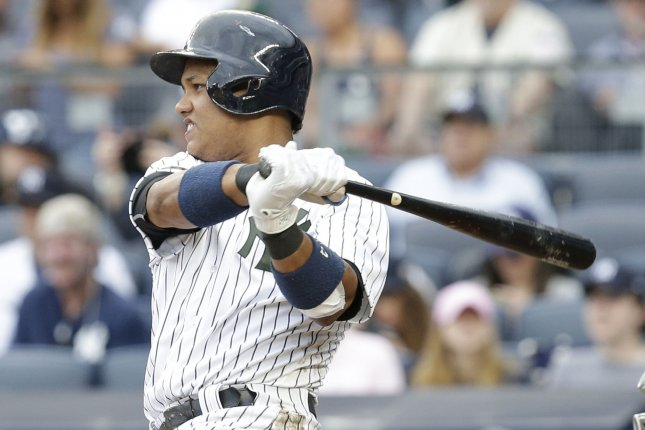 New York Yankees' Starlin Castro hits a home run. File photo by John Angelillo/UPI