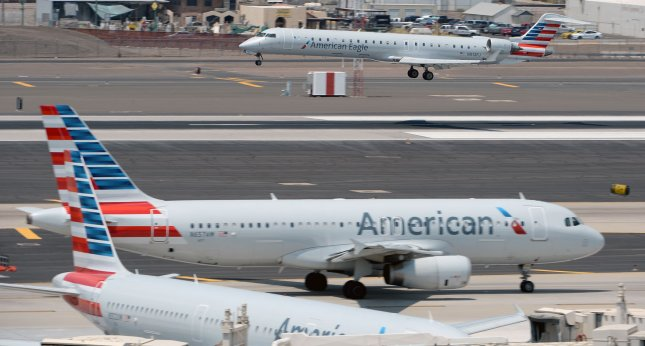 An American Airlines plane lands at Sky Harbor Airport in Phoenix on June 20. American Airlines is one of three U.S. airline companies asking the Trump administration for help competing with airline companies in the Middle East. File Photo by Art Foxall/UPI