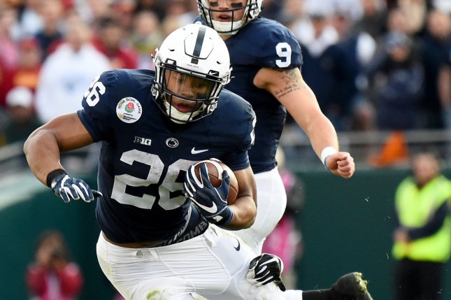Penn State running back Saquon Barkley (28) is tackled by USC Trojans' Leon McQuay III (22) during the 2017 Rose Bowl in Pasadena, California on January 2, 2017. File photo by Juan Ocampo/UPI