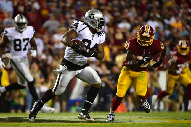 Oakland Raiders running back Marshawn Lynch runs for a first down against the Washington Redskins in the second quarter at FedEx Field in Landover, Maryland on September 24, 2017. File photo by Kevin Dietsch/UPI