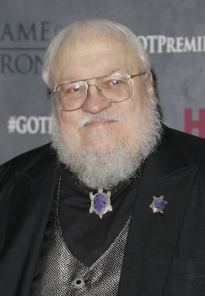 George R.R. Martin arrives on the red carpet at the Game of Thrones Season 4 premiere in New York City on March 18, 2014. File Photo by John Angelillo/UPI