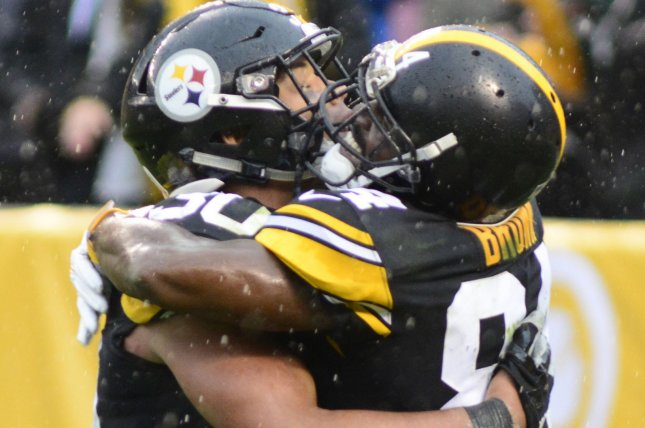 Pittsburgh Steelers running back James Conner (30) celebrates his 22 yard touchdown with Pittsburgh Steelers wide receiver Antonio Brown (84) in the fourth quarter of the Steelers 33-18 win against the Cleveland Browns on Sunday at Heinz Field in Pittsburgh. Photo by Archie Carpenter/UPI