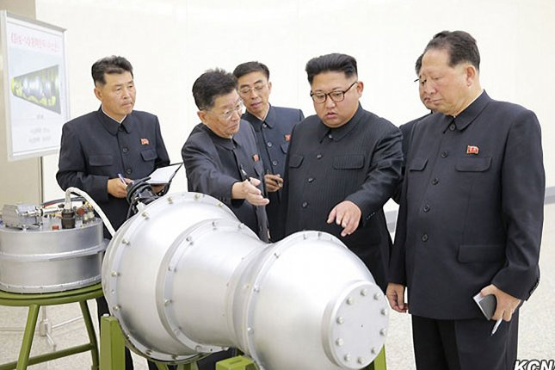 North Korea's Kim Jong Un (C-R) has pledged to build a solid-fuel intercontinental ballistic missile. File Photo by KCNA/UPI