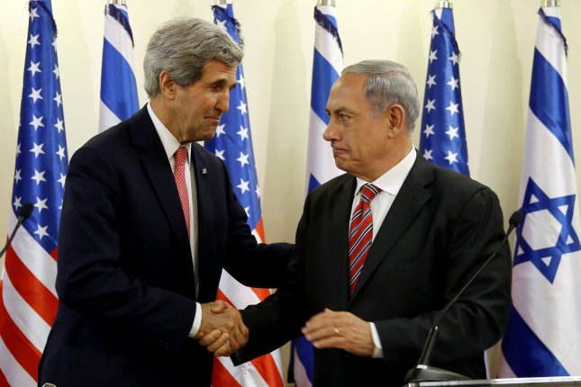 Israeli Prime Minister Benjamin Netanyahu (R) shakes hands with U.S. Secretary of State John Kerry during a press conference following a meeting at Netanyahu's Jerusalem office on December 5, 2013. Kerry insisted that Israel's security was a top priority in talks with Iran on its controversial nuclear program after an initial deal was signed. UPI/Gali Tibbon/Pool
