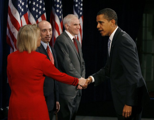 President-elect Barack Obama (R) shakes hands with Mary Schapiro (L) after announcing her as his pick to head the Securities and Exchange Commission, Gary Gensler (2nd L) as head of the Commodity Futures Trading Commission and Daniel Tarullo as a member of the Federal Reserve board during a news conference on December 18, 2008 in Chicago. By appointing these non-cabinet positions at this early date, Obama stressed the importance of reforming regulations governing Wall Street to prevent future economic crises. (UPI Photo/Brian Kersey)