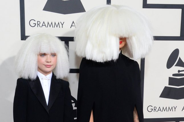 Dancer Maddie Ziegler (L) and singer-songwriter Sia arrive for the 57th Grammy Awards at Staples Center in Los Angeles on February 8, 2015. File Photo by Jim Ruymen/UPI