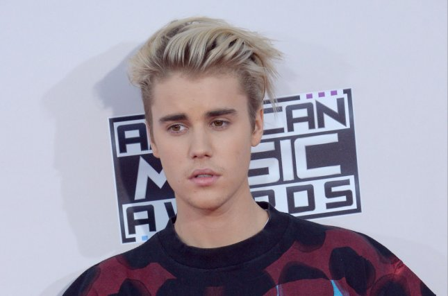 Recording artist Justin Bieber arrives for the 43rd annual American Music Awards on November 22, 2015. Bieber has sided with Kanye West in his feud against Taylor Swift on social media. File Photo by Jim Ruymen/UPI