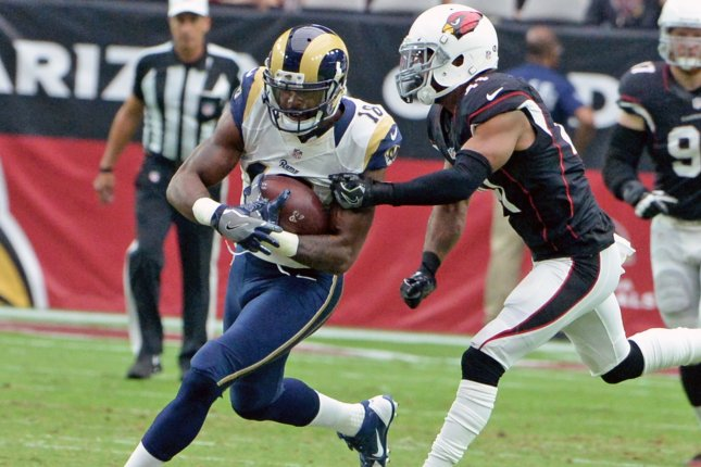 Former Los Angeles Rams wide receiver Kenny Britt (L) picks up a first down in the fourth quarter on October 2, 2016 at University of Phoenix Stadium in Glendale, Arizona. File photo by Art Foxall/UPI