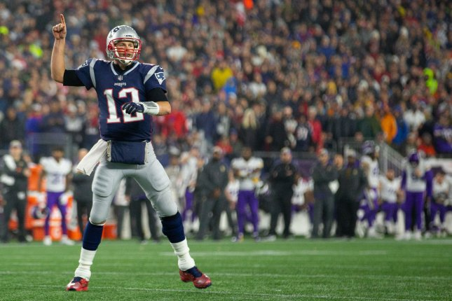 New England Patriots quarterback Tom Brady (12) celebrates after a touchdown by fullback James Develin (not pictured) in the fourth quarter against the Minnesota Vikings on Sunday at Gillette Stadium in Foxborough, Mass. Photo by Matthew Healey/UPI