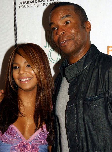 Actress, singer Ashanti poses with co-star David Allen Grier at the April 27, 2005 New York premiere of their ABC telefilm The Muppets' Wizard of Oz at the 2005 Tribeca Film Festival. (UPI Photo/Ezio Petersen)