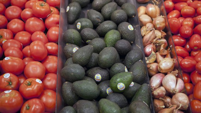 Tomatoes and avacados are stacked together at the King Soopers supermarket in Lakewood, Colorado on June 20, 2012. UPI/Gary C. Caskey