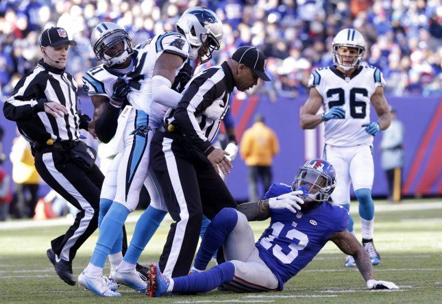 New York Giants Odell Beckham Jr. ends up on the ground after an  altercation with and Carolina Panthers Josh Norman in the first quarter at MetLife  Stadium ... d5e4ef67d