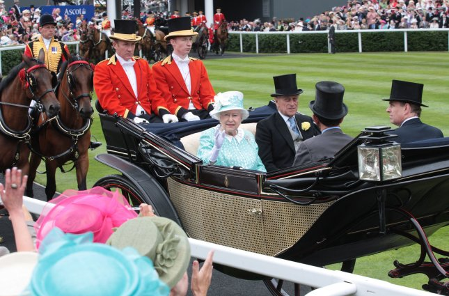 Her Majesty Queen Elizabeth II waves to one of her subjects while riding next to her husband, the Duke of Edinburgh, Prince Philip, at the Royal Ascot on ladies day near Windsor in 2009. The five day racing event is seen as the pinnacle of Britain's horse racing season. File photo by Hugo Philpott/UPI