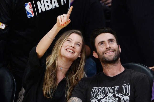 Adam Levine (R) and Behati Prinsloo attend Kobe Bryant's final game with the Los Angeles Lakers on April 13. The couple welcomed their first child in September. File photo by Jim Ruymen/UPI