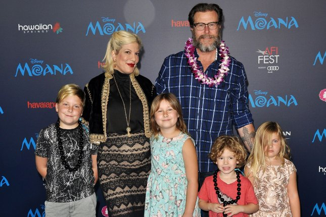 Tori Spelling (second from left), her husband Dean McDermott and their children (L-R) Liam, Stella, Finn and Hattie arrive at the world premiere of Moana on November 14, 2016. The couple are being sued by City National Bank for defaulting on a loan. File Photo by Christine Chew/UPI