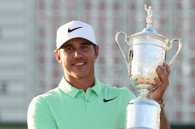 Brooks Koepka poses with the U.S. Open Trophy after the final round of the 117th U.S. Open golf tournament at Erin Hills golf course on June 18, 2017 in Erin, Wisconsin. Koepka shot a 16-under-par 272 to win the tournament by 4 strokes. Photo by Brian Kersey/UPI