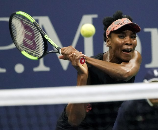 Venus Williams returns a shot from Sloane Stephens during the U.S. Open last month. Photo by Ray Stubblebine/UPI