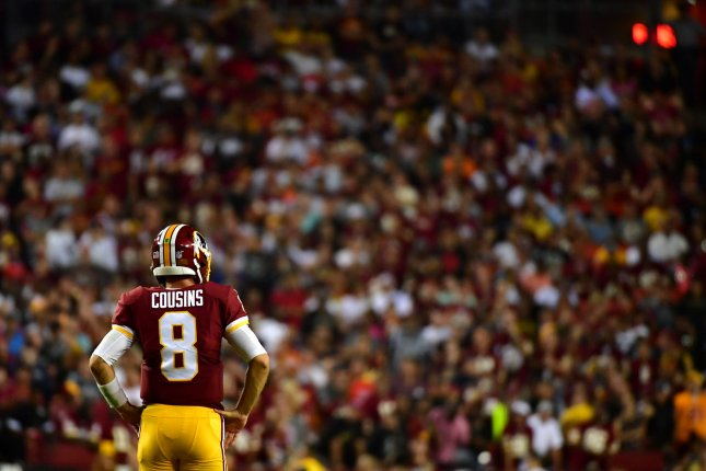 Washington Redskins quarterback Kirk Cousins walks back to the huddle as the Redskins play the Oakland Raiders in the second quarter at FedEx Field in Landover, Maryland on September 24, 2017. File photo by Kevin Dietsch/UPI