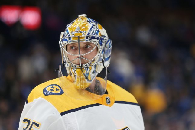 Nashville goaltender Pekka Rinne of Finland skates to his bench during a time out against the St. Louis Blues in the first period on Friday at the Scottrade Center in St. Louis. Photo by Bill Greenblatt/UPI