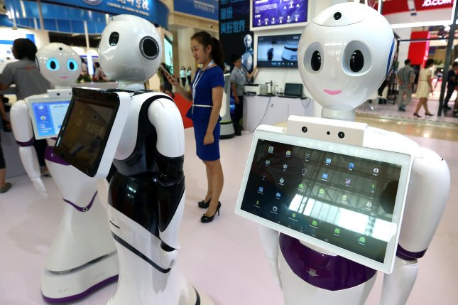 Robots are displayed during the World Intelligence Conference in Tianjin on June 30. A report Wednesday by consulting firm McKinsey & Co. said up to 800 million workers could lose their jobs to automation by 2030. File Photo by Stephen Shaver/UPI
