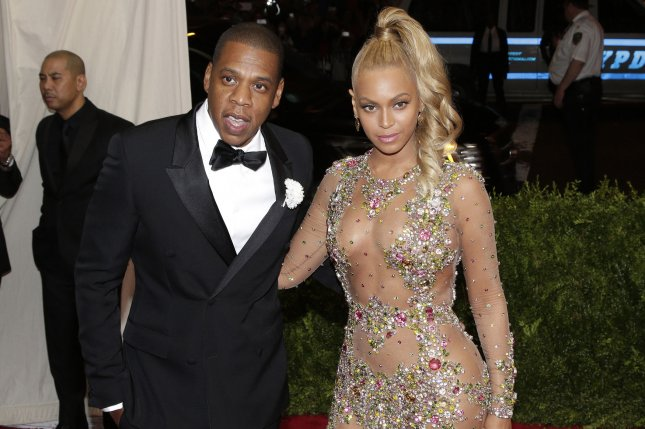 Beyoncé (R), pictured with Jay-Z, discussed the rapper in the September issue of Vogue. File Photo by John Angelillo/UPI