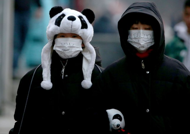Chinese wear protective respiratory masks in Beijing on Saturday as all major Chinese New Year events have been canceled in the capital city in a bid to prevent the spread of the coronavirus, which officials said Wednesday has killed 132 people nationwide. Photo by Stephen Shaver/UPI