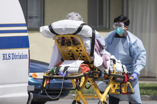 A patient is moved out of Gateway Care & Rehabilitation Center, a skilled nursing facility in Hayward, Calif., on April 9. Experts said it's important to foster diversity among healthcare providers to build trust among patients of color. File Photo by Terry Schmitt/UPI