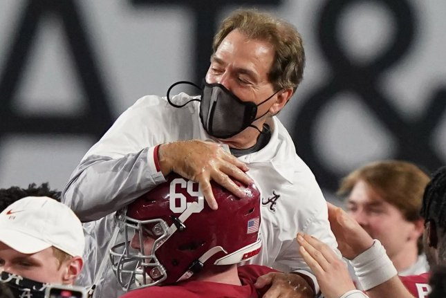 Coach Nick Saban and Alabama players celebrate after winning the College Football Playoff National Championship for the third time Monday in Miami Gardens, Fla. Photo by Hans Deryk/UPI