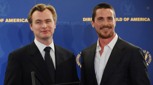 Christopher Nolan (L) appears backstage with his nomination award for outstanding directorial achievement feature film for The Dark Knight and cast member Christian Bale, at the 61st annual Directors Guild of America Awards in Los Angeles on January 31, 2009. (UPI Photo/Jim Ruymen)