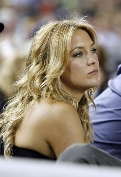 Actress Kate Hudson watches the Boston Red Sox play the New York Yankees at Yankee Stadium in New York City on August 6, 2009. The Yankees defeated the Red Sox 13-6 UPI/John Angelillo