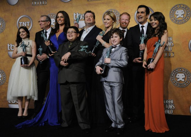 The cast of Modern Family poses backstage after winning the ensemble in a comedy series award at the 17th annual Screen Actors Guild Awards held at the Shrine Auditorium in Los Angeles on January 30, 2011. UPI/Phil McCarten