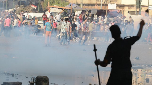 Egyptian protesters throw stones towards riot police during clashes near the US embassy in Cairo on September 13, 2012. UPI/Ahmed Jomaa