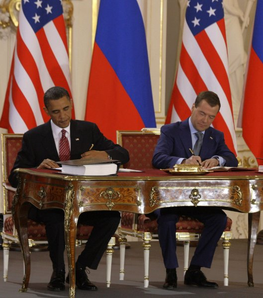 U.S. President Barack Obama (L) and Russian President Dmitry Medvedev sign the new Strategic Arms Reduction Treaty (START) at the Prague Castle in Prague on April 8, 2010. UPI Photo/Alex Natin.