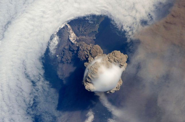 This NASA photo taken by astronauts aboard the International Space Station shows the Sarychev volcano in the early stages of eruption on Russia's Kuril Islands on June 12, 2009. (UPI Photo/NASA)