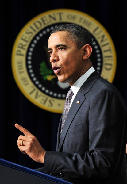 Obama heads for Hawaii after signing payroll tax deal; urges Congress to end the drama
