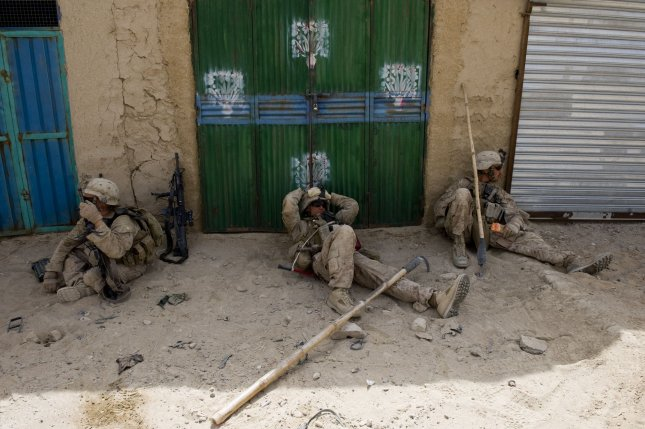 U.S. Marine take a break during a patrol the Safaar Bazar in the Gharmsir District of Helmand province after IEDs where reported in the area in Afghanistan on August 19, 2010. UPI/Hossein Fatemi.