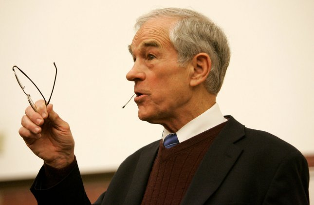 Republican presidential hopeful Rep. Ron Paul (R-TX) addresses supporters at a campaign stop at Des Moines University in Des Moines, Iowa on January 3, 2008. Iowans will gather later in the evening to choose their candidates. (UPI Photo/Brian Kersey)