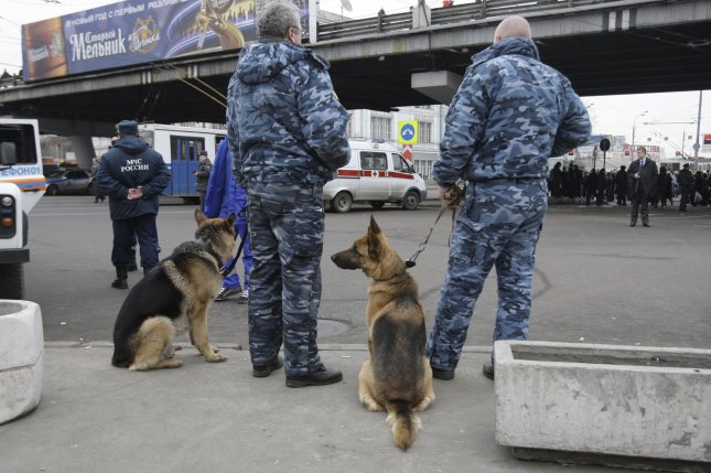 Russian riot police officers stand guard near the exit of Park Kultury metro station in Moscow on March 29, 2010. Two female suicide bombers killed at least 38 people and injured many on two Moscow metro trains in the morning rush hour on Monday. UPI/Alex Natin