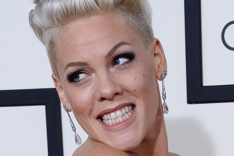 Pink - P!nk appears nude in 90-Foot PETA USA Billboard in
