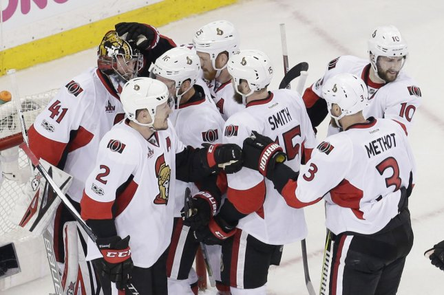 Ottawa Senators Craig Anderson is surrounded and congratulated by teammates after the game against the New York Rangers in game 6 of their Eastern Conference 2nd round series of the NHL Stanley Cup Playoffs at Madison Square Garden in New York City on May 9, 2017. The Senators defeated the Rangers 4-2 and won the series 4-2. Photo by John Angelillo/UPI