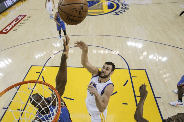 Golden State Warriors' Andrew Bogut shoots over Oklahoma City ThundersÕ Serge Ibaka during Game 5 of the NBA Western Conference Finals at Oracle Arena on in Oakland, California on May 26, 2016. The Warriors defeated the Thunder 120-111. Pool photo by Carlos Avila Gonzalez/UPI