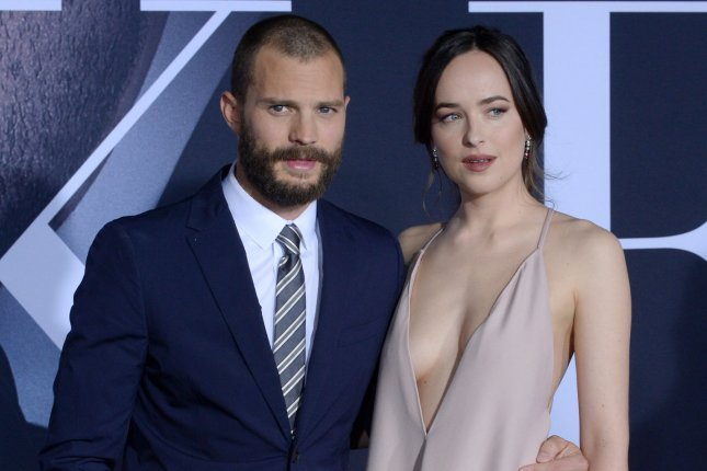 Jamie Dornan (L), pictured with Dakota Johnson, discussed his relationship with the actress on Wednesday's episode of Jimmy Kimmel Live! File Photo by Jim Ruymen/UPI