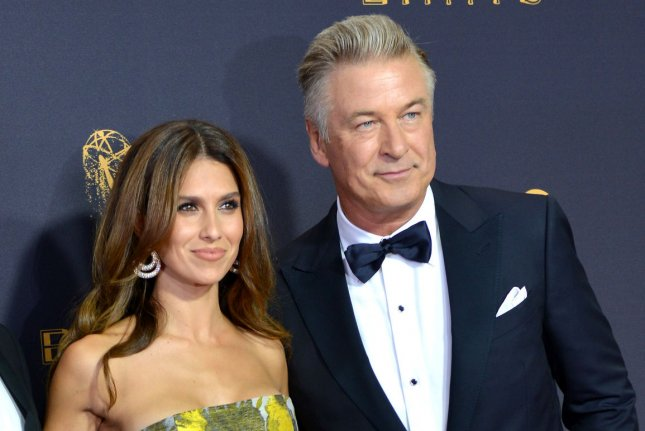 Alec Baldwin (R) and Hilaria Baldwin posted a photo Thursday after welcoming their fourth child. File Photo by Christine Chew/UPI