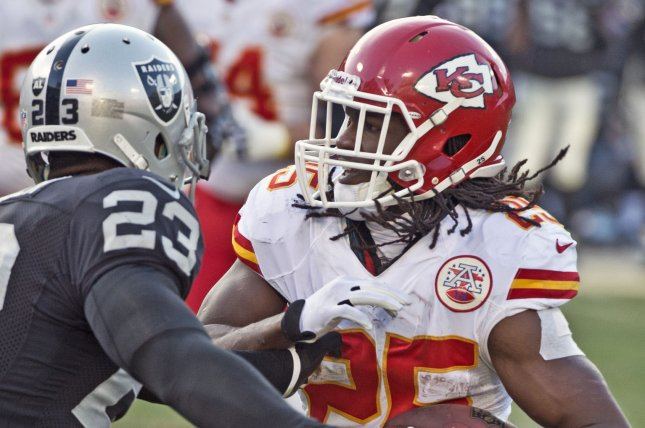 Former Kansas City Chiefs running back Jamaal Charles (25) runs against the Oakland Raiders in the first quarter on December 15, 2013 at O.co Coliseum in Oakland, California. File photo by Terry Schmitt/UPI