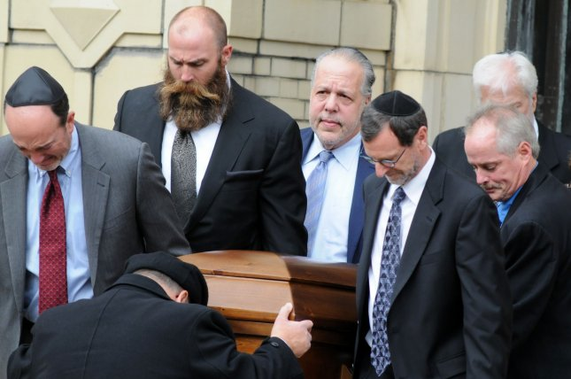 Former Pittsburgh Steelers defensive lineman Brett Keisel (left-center) is one of the pallbearers at the funeral services of brothers Cecil and David Rosenthal on Tuesday at the Rodef Shalom Congregation in Pittsburgh. The brothers were victims of the mass shooting where a gunman killed 11 people at the Tree of Life Synagogue. Photo by Archie Carpenter/UPI