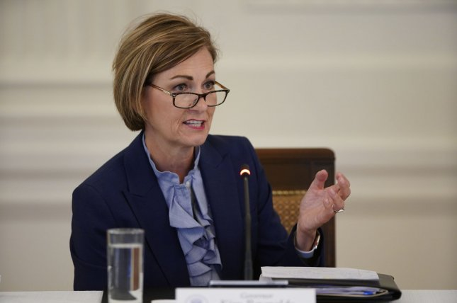 Iowa Gov. Kim Reynolds encouraged a constitutional amendment to make her executive order restoring felon voting rights a permanent law. File Photo by Chris Kleponis/UPI
