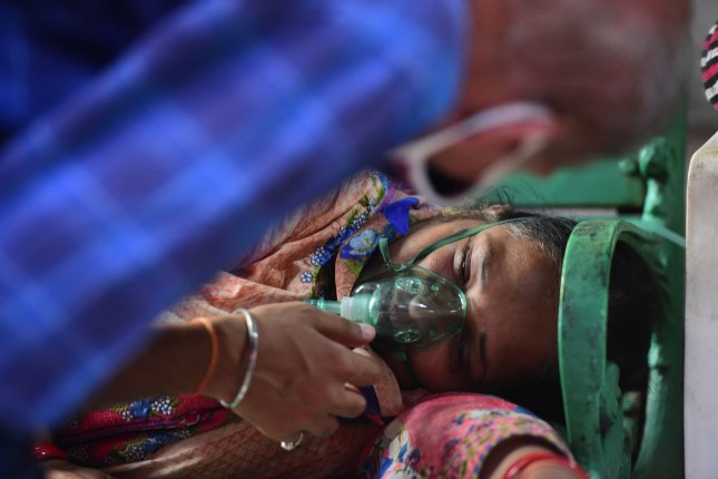 A COVID-19 patient receives free oxygen, provided at a Gurudwara, a Sikh Temple, in Ghaziabad, India's Uttar Pradesh State on Saturday. Photo by Abhishek/UPI