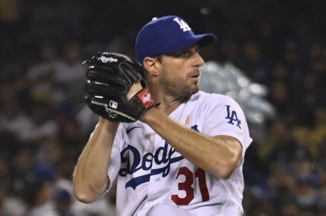 Los Angeles Dodgers starting pitcher Max Scherzer winds up to deliver against the Atlanta Braves in the sixth inning Wednesday at Dodger Stadium in Los Angeles. Photo by Jim Ruymen/UPI